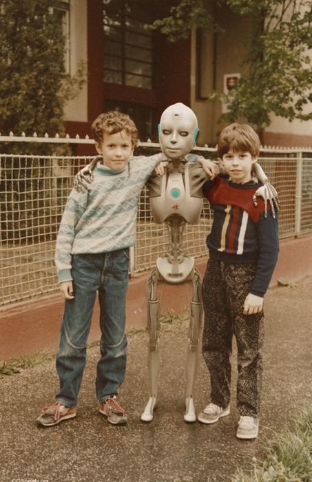 Children with robot in vintage styled photo.
